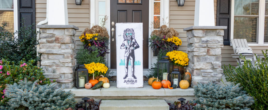 House porch decorated for the fall season with an Original Lull Mattress Box in the center.